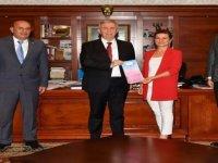 Başkan'dan Mansur Başkana Nezaket Ziyareti