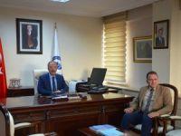 Başkan Can, Rektör Uzun'u Kumluca'ya davet etti